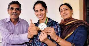 Saina with her parents